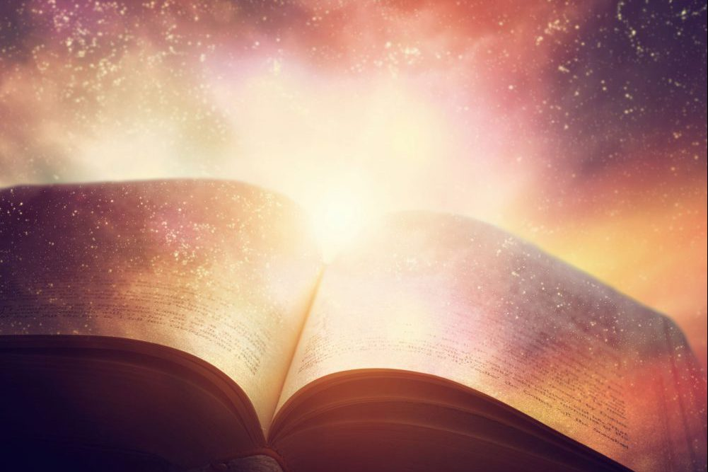 44216756 - open old book merged with magic galaxy sky, universe, stars. concept of literature, fantasy, horoscope, religion etc.